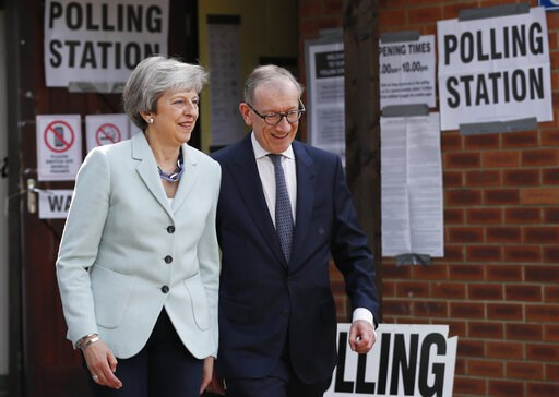 (AP Photo/Frank Augstein). Britain's Prime Minister Theresa May and her husband Philip leave a polling station after voting in the European Elections in Sonning, England, Thursday, May 23, 2019.
