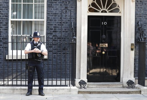 (AP Photo/Alastair Grant). A police officer stands outside 10 Downing Street, the residence of British Prime Minister Theresa May, in London, England, Friday, May 24, 2019. Conservative lawmakers have given May until Friday to announce a departure date...