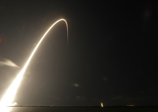 (AP Photo/John Raoux). A Falcon 9 SpaceX rocket, with a payload of 60 satellites for SpaceX's Starlink broadband network, lifts off from Space Launch Complex 40 during a time exposure at the Cape Canaveral Air Force Station in Cape Canaveral, Fla., Thu...