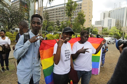 (AP Photo/Khalil Senosi). Kenya gay and Lesbian activists and their supporters gather outside the Milimani Court in Nairobi, Kenya Friday, May 24, 2019. Kenya's High Court is due to rule Friday on whether laws that criminalise same sex relations are un...