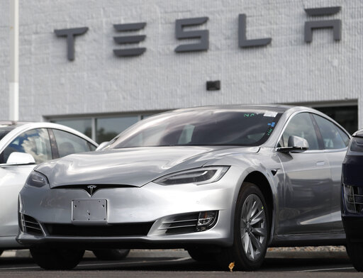 (AP Photo/David Zalubowsi, File). FILE - This July 8, 2018 photo shows Tesla 2018 Model 3 sedans sit on display outside a Tesla showroom in Littleton, Colo. Late last year, Tesla Inc. was fully charged and cruising down the highway on Autopilot. Shares...