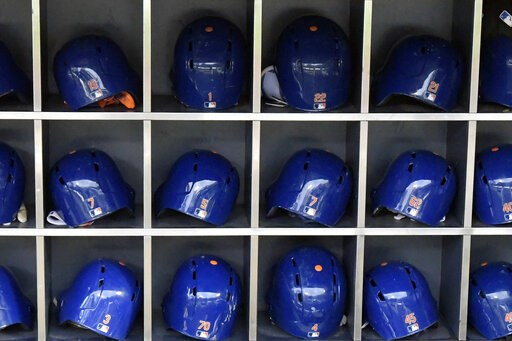 (AP Photo/Bill Kostroun). This Sept. 28, 2018 photo shows batting helmets in a rack before a Major League Baseball game in New York. According to study published Friday, May 24, 2019, NFL players may be more likely to die from brain diseases and heart ...