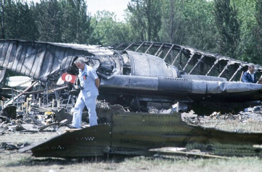 (AP Photo/Fred Jewell File). FILE - In this May 26, 1979 file photo, investigators view the wreckage of the ill-fated American Airlines Flight 191 to Los Angeles, which crashed on take off from O'Hare International Airport in Chicago. Decades later, th...