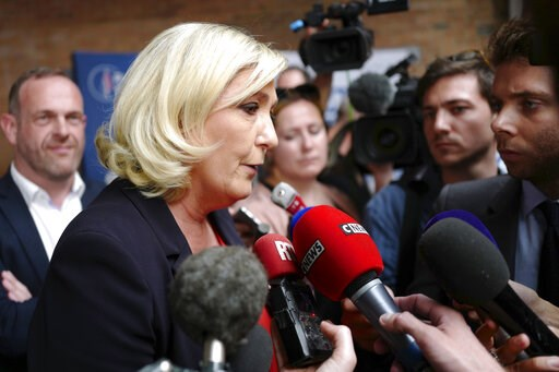 (AP Photo/Michel Spingler). French far-right leader Marine Le Pen answers reporters after a press conference in Henin-Beaumont, northern France, Friday, May. 24, 2019. Polls suggest that Le Pen's party will be among France's top two vote-getters in the...