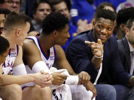 (AP Photo/Orlin Wagner, File). FILE - In this Feb. 2, 2019, file photo, Kansas forward Silvio De Sousa, right, points to teammates during the second half of an NCAA college basketball game against Texas Tech in Lawrence, Kan. De Sousa will be eligible ...