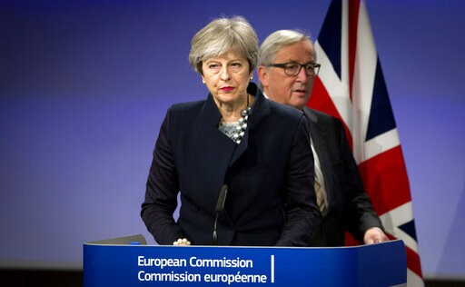 (AP Photo/Virginia Mayo, File). In this Monday, Dec. 4, 2017 file photo, European Commission President Jean-Claude Juncker, right, walks behind British Prime Minister Theresa May prior to addressing a media conference at EU headquarters in Brussels. As...