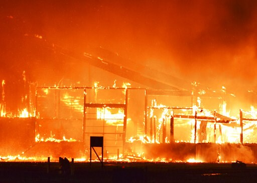 (Will Vraspir/The Hastings Tribune via AP). The Cooperative Producers Inc. dry fertilizer plant near U.S. Hwy 6 and Showboat Blvd. in Hastings, Neb., burns Thursday, May 23, 2019,. Hastings Fire and Rescue responded about 11:30 p.m. and called for mutu...