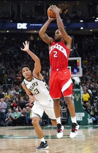 (AP Photo/Morry Gash). Toronto Raptors' Kawhi Leonard shoots in front of Milwaukee Bucks' Malcolm Brogdon during the second half of Game 5 of the NBA Eastern Conference basketball playoff finals Thursday, May 23, 2019, in Milwaukee. The Raptors won 105...