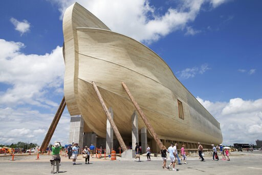 (AP Photo/John Minchillo, File). FILE - In this July 5, 2016, file photo, visitors pass outside the front of a replica Noah's Ark at the Ark Encounter theme park during a media preview day, in Williamstown, Ky. In the Bible, the ark survived an epic fl...