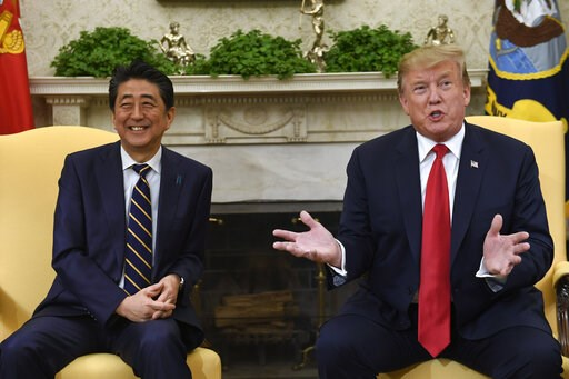 (AP Photo/Susan Walsh, File). FILE - In this April 26, 2019, file photo, U.S. President Donald Trump, right, speaks while meeting with Japanese Prime Minister Shinzo Abe, left, in the Oval Office of the White House in Washington. Trump's Japan visit st...