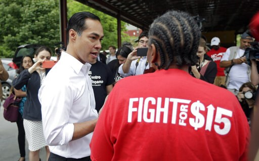 (AP Photo/Gerry Broome). In this May 23, 2019, photo, Democratic presidential candidate and former U.S. Department of Housing and Urban Development Julian Castro speaks with a supporter before rallying with McDonald's employees and other activists in D...
