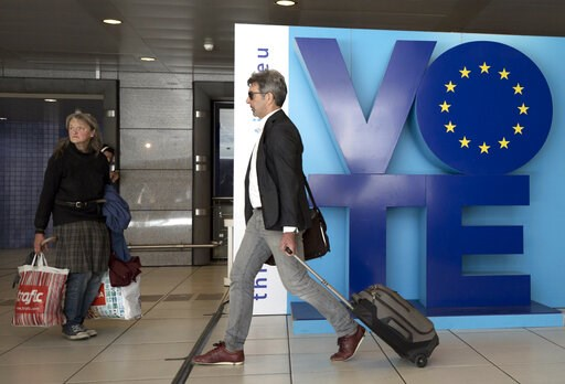 (AP Photo/Virginia Mayo). A man walks by an installation encouraging people to vote in the European elections at Luxembourg metro station in Brussels, Friday, May 24, 2019. Some 400 million Europeans from 28 countries will head to the polls May 23-26 t...