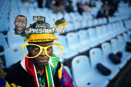 (AP Photo/Jerome Delay). African National Congress party (ANC) supporters gather for the swearing-in ceremony for South African President Cyril Ramaphosa at Loftus Versfeld stadium in Pretoria, South Africa, Saturday, May 25, 2019. Ramaphosa has vowed ...