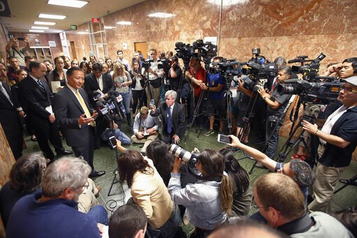 (AP Photo/Tony Avelar, File). FILE - In this July 7, 2015, file photo, San Francisco Public Defender Jeff Adachi, left, talks to members of the media after Francisco Sanchez' arraignment in San Francisco. On Friday, May 24, 2019, San Francisco Police C...