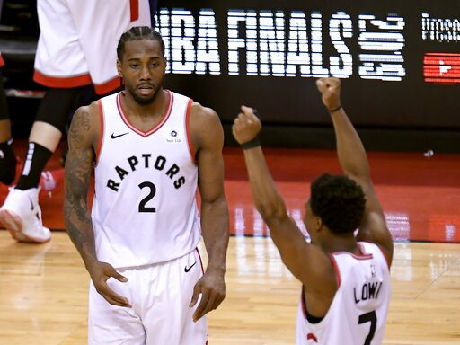 (Frank Gunn/The Canadian Press via AP). Toronto Raptors' Kawhi Leonard (2) and Kyle Lowry (7) react during the second half of Game 6 of the team's NBA basketball playoffs Eastern Conference finals against the Milwaukee Bucks on Saturday, May 25, 2019, ...