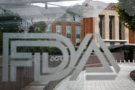 (AP Photo/Jacquelyn Martin, File). FILE - This Thursday, Aug. 2, 2018, file photo shows the U.S. Food and Drug Administration building behind FDA logos at a bus stop on the agency's campus in Silver Spring, Md. The Food and Drug Administration's first ...