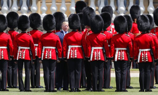 (AP Photo/Frank Augstein). President Donald Trump reviews an honor guard during a ceremonial welcome in the garden of Buckingham Palace in London, Monday, June 3, 2019 on the opening day of a three day state visit to Britain.