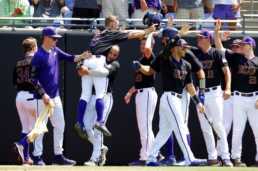 (Ethan Hyman/The News & Observer via AP). East Carolina's Turner Brown (8) is carried by Jake Kuchmaner (29) as he celebrates after scoring in the fifth inning against Campbell in an NCAA college baseball tournament regional game in Greenville, N.C...