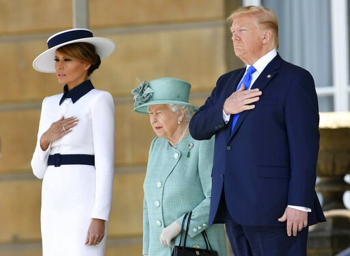 (Toby Melville/Pool via AP). US President Donald Trump and first lady Melania Trump attend a welcome ceremony with Britain's Queen Elizabeth II in the garden of Buckingham Palace, in London, for Monday June 3, 2019, on the first day of a three day stat...