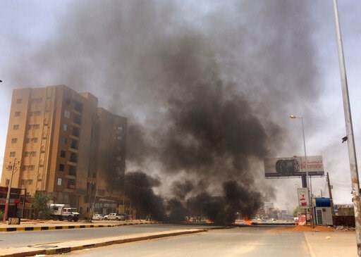 (AP Photo). Burning tires set by protesters produce black smoke on road 60, near Khartoum's army headquarters, in Khartoum, Sudan, Monday, June 3, 2019. Sudanese protest leaders say at least 13 people have been killed in the military's assault on the s...