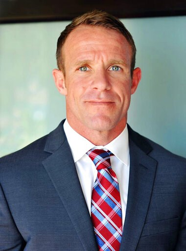 (Andrea Gallagher via AP, File). FILE - This 2018 file photo provided by Andrea Gallagher shows her husband, Navy SEAL Edward Gallagher, who has been charged with murder in the 2017 death of an Iraqi war prisoner. Lawyers for Gallagher are seeking to h...