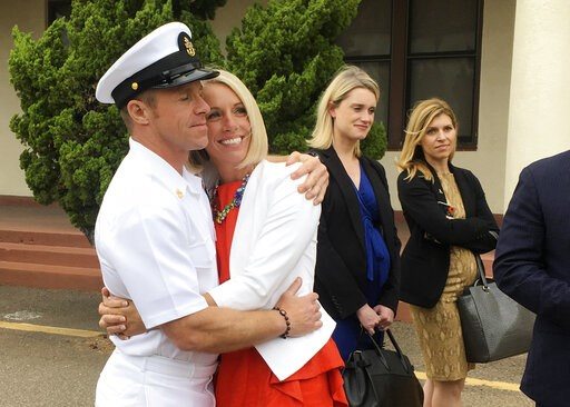 (AP Photo/Julie Watson). Navy Special Operations Chief Edward Gallagher, left, hugs his wife, Andrea Gallagher, after leaving a military courtroom on Naval Base San Diego, Thursday, May 30, 2019, in San Diego. The decorated Navy SEAL facing a murder tr...