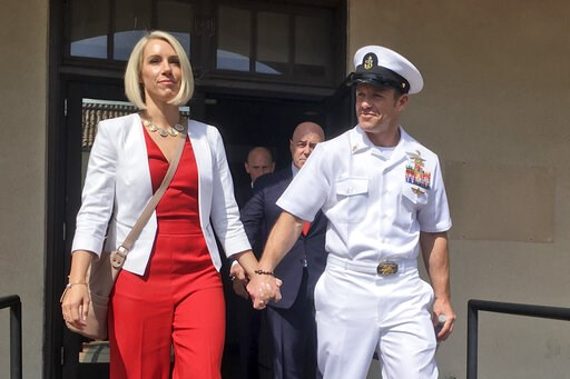(AP Photo/Julie Watson). Navy Special Operations Chief Edward Gallagher leaves a military courtroom on Naval Base San Diego with his wife, Andrea Gallagher, Friday, May 31, 2019, in San Diego. The decorated Navy SEAL faces a murder trial in the death o...