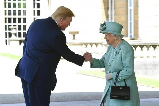(Victoria Jones/Pool via AP). Britain's Queen Elizabeth II greets President Donald Trump as he arrives for a welcome ceremony in the garden of Buckingham Palace, in London, Monday, June 3, 2019, on the first day of a three day state visit to Britain.