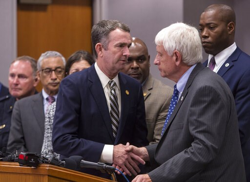 (Kaitlin McKeown/The Virginian-Pilot via AP). Virginia Gov. Ralph Northam , center, shakes the hand of Virginia Beach (Va.) Mayor Bobby Dyer after giving remarks during a news conference regarding the shooting at a municipal building,Friday, May 31, 20...