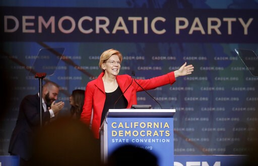 (AP Photo/Jeff Chiu). Democratic presidential candidate Sen. Elizabeth Warren, D-Mass., waves before speaking during the 2019 California Democratic Party State Organizing Convention in San Francisco, Saturday, June 1, 2019.