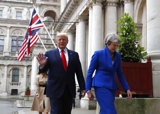 (AP Photo/Frank Augstein). Britain's Prime Minister Theresa May and President Donald Trump walk through the Quadrangle of the Foreign Office for a joint press conference in central London, Tuesday, June 4, 2019.