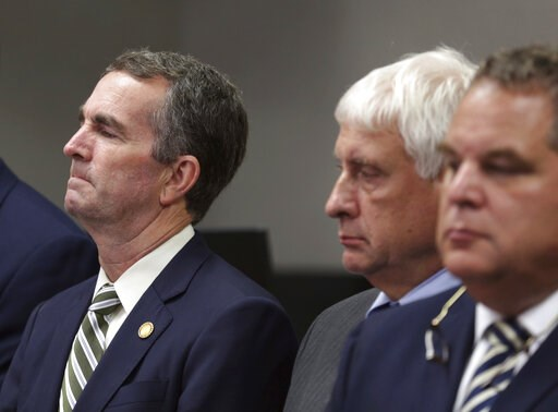 (AP Photo/Vicki Cronis-Nohe). Virginia Gov/ Ralph Northam, left, listens during a news conference in Virginia Beach, Va. Friday, May 31, 2019. A longtime city employee opened fire in a municipal building in Virginia Beach on Friday, killing several peo...