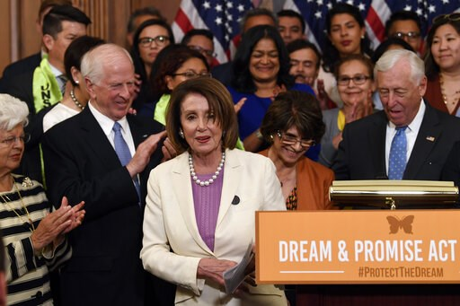 (AP Photo/Susan Walsh). House Speaker Nancy Pelosi of Calif., center, is applauded after she spoke at an event on Capitol Hill in Washington, Tuesday, June 4, 2019, regarding the American Dream and Promise Act which offers a pathway to citizenship for ...