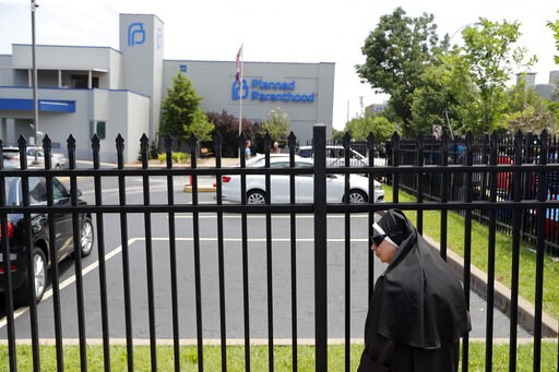 (AP Photo/Jeff Roberson). Sister Benedicta, a Carmelite nun, stands at a gate outside the Planned Parenthood clinic in St. Louis during an anti-abortion rally Tuesday, June 4, 2019. A judge is considering whether the clinic, Missouri's only abortion pr...