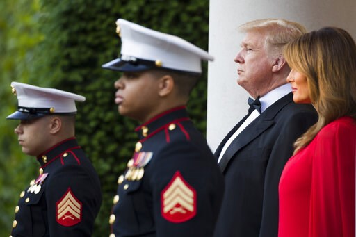 (AP Photo/Alex Brandon). President Donald Trump and first lady Melania Trump await the arrival of Prince Charles, and Camilla, Duchess of Cornwall, before a dinner at the U.S. ambassador's residence, Tuesday, June 4, 2019, in central London.