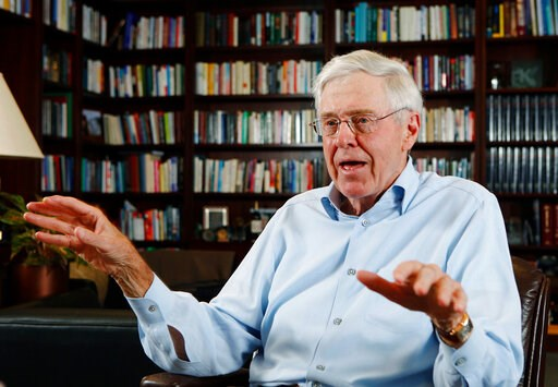 (Bo Rader/The Wichita Eagle via AP, File). FILE - In this May 22, 2012, file photo, Charles Koch speaks in his office at Koch Industries in Wichita, Kan. If a billionaire's approach to philanthropy is a reflection of himself, Koch's latest initiative t...