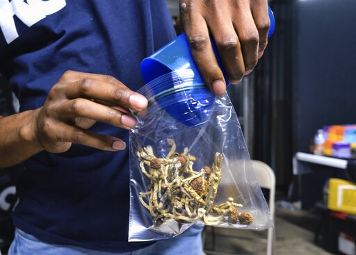 (AP Photo/Richard Vogel). In this Friday, May 24, 2019 photo a vendor bags psilocybin mushrooms at a cannabis marketplace in Los Angeles. Oakland City Council will vote Tuesday, June 4, 2019, to decriminalize the possession and use of entheogenic, or p...