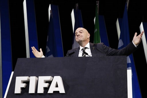 (AP Photo/Alessandra Tarantino). FIFA President Gianni Infantino gestures as he walks on the stage before the start of the 69th FIFA congress in Paris, Wednesday, June 5, 2019.