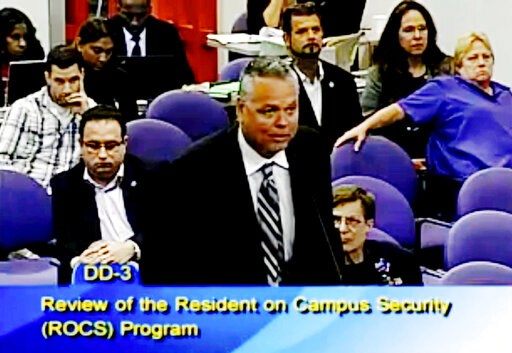 (Broward County Public Schools via AP, File). FILE - In this Feb. 18, 2015, file frame from video from Broward County Public Schools, school resource officer Scot Peterson talks during a school board meeting of Broward County, Fla. Peterson, the then-F...