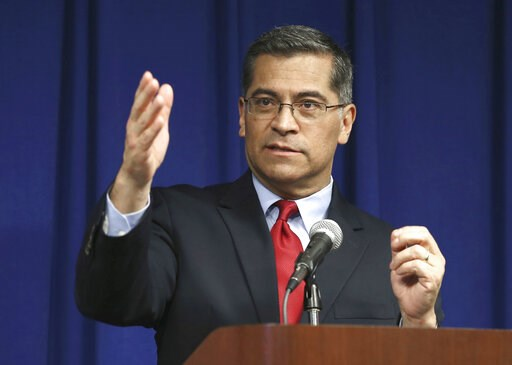 (AP Photo/Rich Pedroncelli, File). FILE - In this March 5, 2019 file photo, California Attorney General Xavier Becerra speaks during a news conference in Sacramento, Calif. California authorities have charged the leader and self-proclaimed apostle of L...