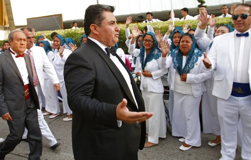 """(AP Photo). In this Aug. 14, 2018, photo, Joaquin Garcia greets members of his church """"La Luz del Mundo"""" in Guadalajara, Mexico. Garcia, the leader and self-proclaimed apostle of La Luz del Mundo, a controversial church that claims over 1 million follo..."""