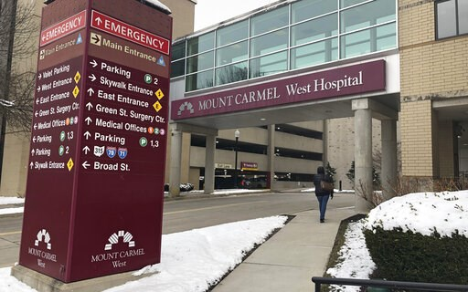 (AP Photo/Andrew Welsh Huggins, File). FILE - This Jan. 15, 2019 file photo shows the main entrance to Mount Carmel West Hospital in Columbus, Ohio.  Authorities are set to give an update on the criminal investigation of an intensive care doctor accuse...