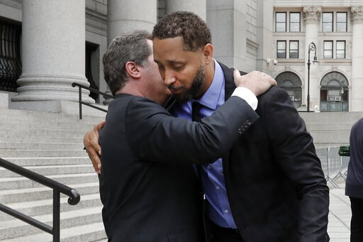 (AP Photo/Richard Drew). Former assistant basketball coach for the University of Southern California Tony Bland, right, is embraced by his attorney Jeffrey Lichtman as they leave federal court in New York, Wednesday, June 5, 2019. Bland was the first o...