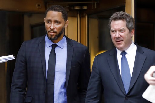 (AP Photo/Richard Drew). Former assistant basketball coach for the University of Southern California Tony Bland, left, and his attorney Jeffrey Lichtman, leave federal court in New York, Wednesday, June 5, 2019. Bland was the first of four ex-coaches c...