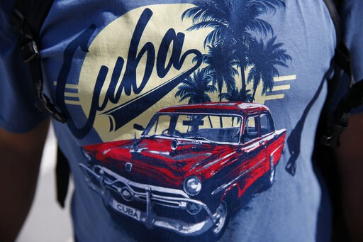 (AP Photo/Brynn Anderson). Israel Sepulveda, 43, of New York, wears a Cuba shirt as he leaves a cruise from Cuba out of Port Everglades on Wednesday, June 5, 2019, in Fort Lauderdale, Fla. The Trump administration on Tuesday imposed major new travel re...