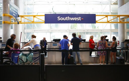 (AP Photo/Brynn Anderson). Passengers load checked baggage and get tickets to travel to Cuba at the Fort Lauderdale-Hollywood International Airport on Tuesday, June 4, 2019, in Fort Lauderdale, Fla. The Trump administration on Tuesday imposed major new...