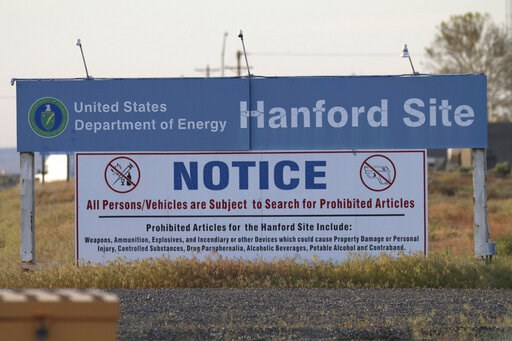 (AP Photo/Manuel Valdes, File). FILE - In this May 9, 2017, file photo, signs are posted at an entrance to the Hanford Nuclear Reservation in Richland, Wash.The state of Washington believes the federal government is unlikely to meet legal deadlines for...