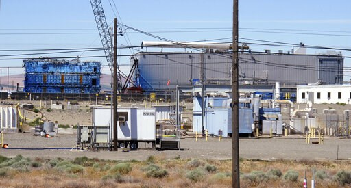 (AP Photo/Nicholas K. Geranios, File). FILE - This May 13, 2017, file photo shows a portion of the Plutonium Finishing Plant on the Hanford Nuclear Reservation near Richland, Wash. The state of Washington believes the federal government is unlikely to ...