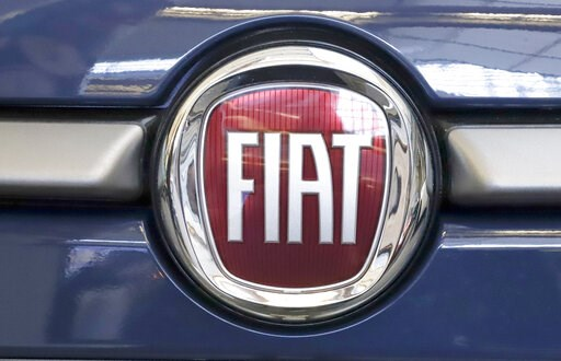 (AP Photo/Gene J. Puskar, File). FILE - In this Feb. 14, 2019, file photo, this is the Fiat logo is mounted on a 2019 500 L on display at the 2019 Pittsburgh International Auto Show in Pittsburgh. French carmaker Renault looks set to give its approval ...