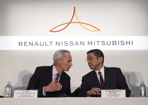 (AP Photo/Eugene Hoshiko, File). FILE - In this March 12, 2019, photo, Renault Chairman Jean-Dominique Senard, left, and Nissan CEO Hiroto Saikawa speak at the start of a joint press conference following a board meeting at the Nissan headquarters in Yo...